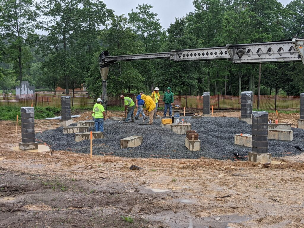 Stone is Placed by Construction Workers